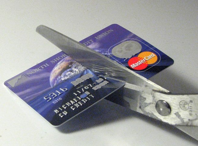 Cut up your credit card - most of which have high interest rates and are far too tempting for over-spending